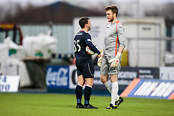 Falkirk's Mark Millar with Queen of the South's keeper Zander Clark before the penalty.<br /> Falkirk 1 v 0 Queen of the South, Scottish Championship game today at the Falkirk Stadium.<br /> © Michael Schofield.
