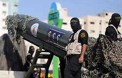 October 4, 2018 - Gaza City, Gaza Strip - Palestinian members of the Al-Quds Brigades, the military wing of the Islamic Jihad group, march with their weapons to show loyalty for the Iranian-backed Palestinian movement's newly elected leader Ziad al-Nakhalah during a rally along the streets of Gaza. (Credit Image: © Ashraf Amra/APA Images via ZUMA Wire)