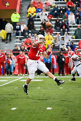 13 October 2012: Matt Brown makes a pass with both feet off the ground during an NCAA football game between the Youngstown State Penguins and the Illinois State Redbirds.  The Redbirds won the game by a score of 35-28 at Hancock Stadium in Normal Illinois