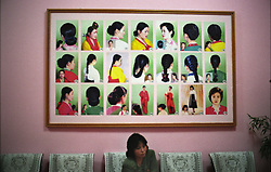 Pyongyang, North Korea, April/May 2004. Pyongyang Health Complex, a spa/center where people can take baths, sauna's, massage, haircuts, take a swim etc. <br /> Woman waiting to get a haircut. (Photo by Teun Voeten) *** Please Use Credit from Credit Field ***