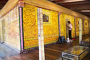 Man painting decorated wall Gangaramaya Buddhist Temple, Colombo, Sri Lanka, Asia