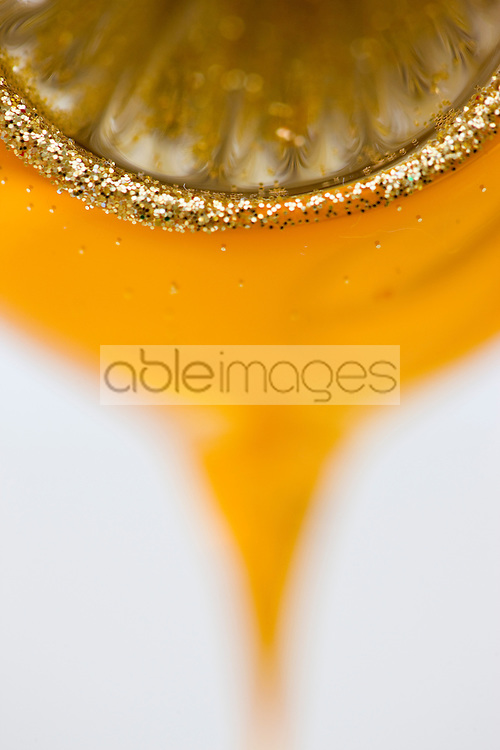 Extreme close up of a yellow and gold Christmas bauble