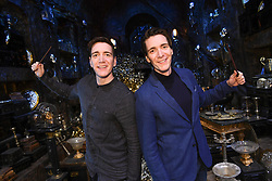 EDITORIAL USE ONLY (Left to right) James Phelps and Oliver Phelps in the Lestrange Vault set at the original Gringotts Wizarding Bank at Warner Bros Studio Tour London, which opens to the public on Saturday 6th April.