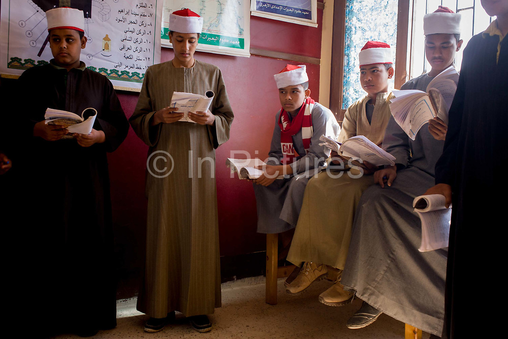 Schoolboys learn verses from the Koran during a religious class in a classroom at the Islamic Koom al-Bourit Institute for Boys in the village of Qum (Koom), on the West Bank of Luxor, Nile Valley, Egypt. Islam in Egypt is the dominant religion in a country with around 80 million Muslims, comprising 94.7% of the population, as of 2010. Almost the entirety of Egypt's Muslims are Sunnis, with a small minority of Shia and Ahmadi Muslims. The latter, however, are not recognised by Egypt.
