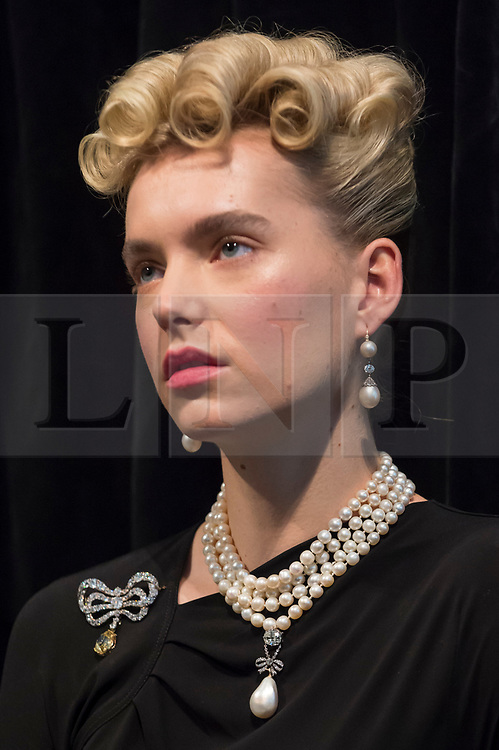"""© Licensed to London News Pictures. 19/10/2018. LONDON, UK. A model wears Marie Antoinette's jewels comprising (L to R) a diamond brooch, second half of the 18th century (Est. USD 50k-80k), a natural pearl and diamond necklace comprising three rows of 116 graduated pearls (Est USD200k-300k), a natural pearl and diamond necklace (Est USD40k-70k), """"Queen Marie Antoinette's Pearl"""", a natural pearl and diamond pendant 18th century set (Est USD1m-2m), and a pair of natural and pearl diamond pendant earrings, late 18th century (Est USD200k-300k).  Preview of Sotheby's """"Royal Jewels from the Bourbon-Parma Family"""", a family descended from Louis XIV of France, the Holy Roman Emperors and from Pope Paul III, with links to the most important ruling families of Europe. Led by a breath-taking group of jewels which once belonged to Marie Antoinette, queen of France, the collection of jewels will be offered for sale at Sotheby's in Geneva on 14 November 2018.  Photo credit: Stephen Chung/LNP"""