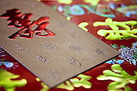 Traditional decorative Chinese writing and script on  celebratory envelopes.