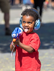 London, August 27 2017. A little boy with his water gun on Ladbroke Grove as Family Day of the Notting Hill Carnival gets underway. The Notting Hill Carnival is Europe's biggest street party held over two days of the bank holiday weekend, attracting over a million people. © Paul Davey.