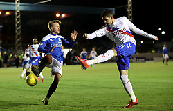 Cowdenbeath's Fraser Mullen and Rangers' Kyle Lafferty battle for the ball during the William Hill Scottish Cup fourth round match at Central Park, Cowdenbeath.