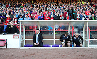 Nottingham Forest's Manager Billy Davies (seated, left) sits in the dug-out in front of the Nottingham Forest fans before kick off.. - (Photo by Chris Vaughan/CameraSport) - ..Football - npower Football League Championship - Nottingham Forest v Barnsley - Saturday 20th April 2013 - The City Ground - Nottingham..© CameraSport - 43 Linden Ave. Countesthorpe. Leicester. England. LE8 5PG - Tel: +44 (0) 116 277 4147 - admin@camerasport.com - www.camerasport.com