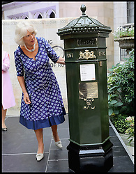 Image ©Licensed to i-Images Picture Agency. 06/09/2016. London, United Kingdom. Royal Mail  500th Anniversary. <br /> <br /> Camilla, Duchess of Cornwall examines a Penfold Postbox she just unveiled as she attends a reception to mark the 500th Anniversary of the Royal Mail at Merchant Taylor's Hall at  on September 6, 2016 in London, England<br /> <br /> Picture by  i-Images / Pool