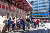 Early morning queue at the reduced price theatre tickets booth, Leicester Square, London, UK, June, 2018, 201806234422.<br />