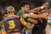 BRISBANE, AUSTRALIA - APRIL 25:  Ben Te'o of the Rabbitohs is tackled during the round 8 NRL match between the Brisbane Broncos and the South Sydney Rabbitohs at Suncorp Stadium on April 25, 2014 in Brisbane, Australia.  (Photo by Matt Roberts/Getty Images) *** Local Caption *** Ben Te'o