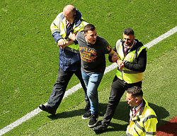 23 April 2017 - EFL Championship Football - Aston Villa v Birmingham City - Stewards remove a pitch invader - Photo: Paul Roberts / Offside