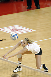 24 November 2006: Sara Thomas scoops out a dig during a Quarterfinal match between the Evansville University Purple Aces and the Missouri State University Bears.The Tournament was held at Redbird Arena on the campus of Illinois State University in Normal Illinois.<br />