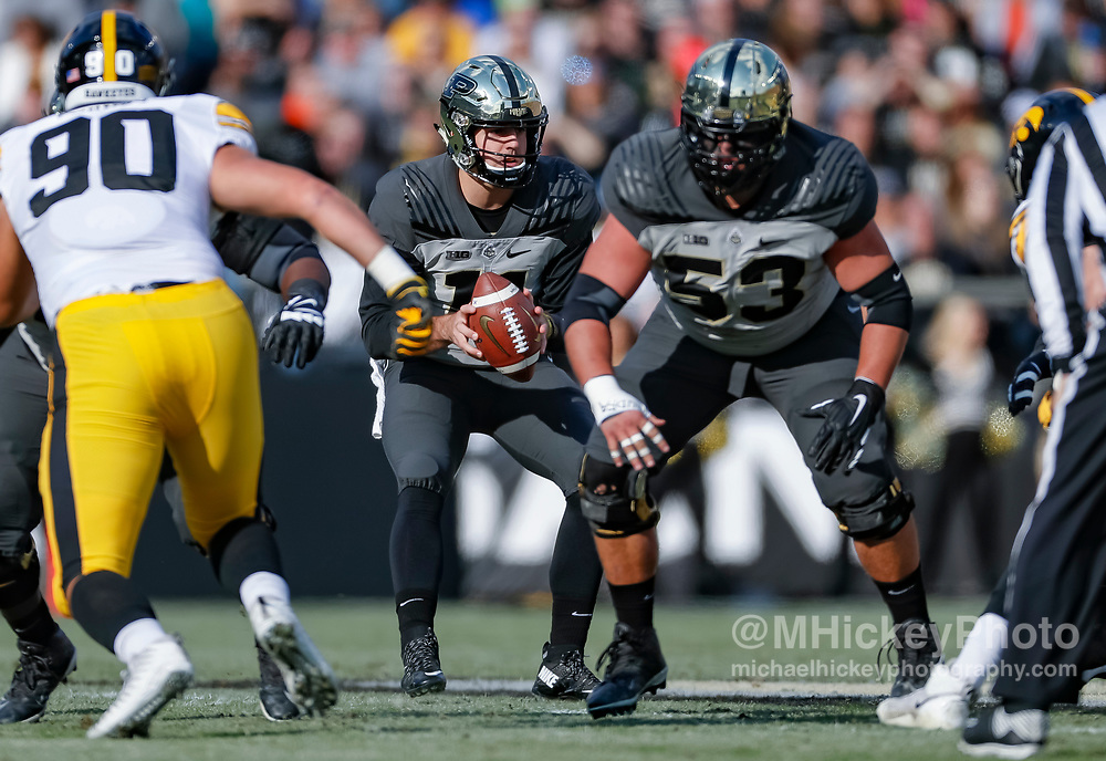WEST LAFAYETTE, IN - NOVEMBER 03: David Blough #11 of the Purdue Boilermakers takes the snap during the game against the Iowa Hawkeyes at Ross-Ade Stadium on November 3, 2018 in West Lafayette, Indiana. (Photo by Michael Hickey/Getty Images) *** Local Caption *** David Blough