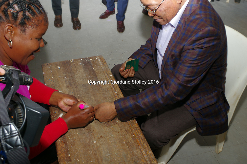 NKANDLA - 3 August 2016 - An election official marks the finger of South Africa's President Jacob Zuma (right) before he cast his vote at Ntolwane Primary School in the country's local government elections. Picture: Allied Picture Press/APP