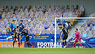 Ollie Palmer of AFC Wimbledon  rises high to score for AFC Wimbledon the EFL Sky Bet League 1 match between AFC Wimbledon and Lincoln City at Plough Lane, London, United Kingdom on 2 January 2021.