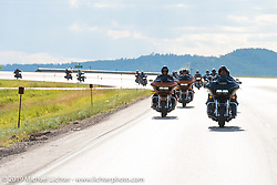 Riding from Deadwood to Sturgis, SD with actor Geoff Stults at the lead for the reveal of the new Harley-Davidson Road Glide during Sturgis Black Hills Rally. SD, USA. August 1, 2014.  Photography ©2014 Michael Lichter.