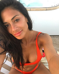 """Nicole Scherzinger releases a photo on Instagram with the following caption: """"Happy 4th of July everyone! \ud83c\uddfa\ud83c\uddf8\ud83c\udf89\ud83d\udc99 God Bless\ud83d\ude4f\ud83c\udffd\u2764\ufe0f @cavotagoomykomos @howelltalentrelations #mykonos"""". Photo Credit: Instagram *** No USA Distribution *** For Editorial Use Only *** Not to be Published in Books or Photo Books ***  Please note: Fees charged by the agency are for the agency's services only, and do not, nor are they intended to, convey to the user any ownership of Copyright or License in the material. The agency does not claim any ownership including but not limited to Copyright or License in the attached material. By publishing this material you expressly agree to indemnify and to hold the agency and its directors, shareholders and employees harmless from any loss, claims, damages, demands, expenses (including legal fees), or any causes of action or allegation against the agency arising out of or connected in any way with publication of the material."""