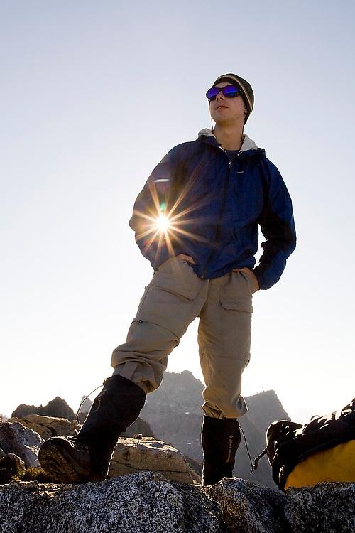 Brian Polagye stands proudly on Hurricane Ridge, Glacier Peak Wilderness, Washington, as the sun bursts through.