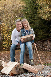 Father and daughter chopping wood, Bavaria