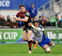 Owen Farrell (Saracens) is tackled - Photo mandatory by-line: Patrick Khachfe/JMP - Tel: Mobile: 07966 386802 18/01/2014 - SPORT - RUGBY UNION - Allianz Park, London - Saracens v Connacht Rugby - Heineken Cup.