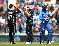 New Zealand's Jimmy Neesham (centre) celebrates after taking the wicket of India's Dinesh Karthik (right) during the ICC Cricket World Cup Warm up match at The Oval, London.