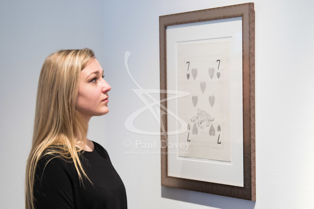 """Christies, St James, London, March 4th 2016. A woman admires Sir Peter Blake's pencil on paper """"Fish & Chips"""", 2004, at the preview for the It's Our World charity auction at Christie's. Over 40 leading artists including David Hockney, Sir Antony Gormley, David Nash, Sir Peter Blake, Yinka Shonibare, Sir Quentin Blake, Emily Young and Maggi Hambling have committed artworks to the It's Our World Auction in support of The Big Draw and Jupiter Artland Foundation, to be sold at Christie's London on 10 March 2016.<br />  ///FOR LICENCING CONTACT: paul@pauldaveycreative.co.uk TEL:+44 (0) 7966 016 296 or +44 (0) 20 8969 6875. ©2015 Paul R Davey. All rights reserved."""