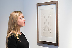 "Christies, St James, London, March 4th 2016. A woman admires Sir Peter Blake's pencil on paper ""Fish & Chips"", 2004, at the preview for the It's Our World charity auction at Christie's. Over 40 leading artists including David Hockney, Sir Antony Gormley, David Nash, Sir Peter Blake, Yinka Shonibare, Sir Quentin Blake, Emily Young and Maggi Hambling have committed artworks to the It's Our World Auction in support of The Big Draw and Jupiter Artland Foundation, to be sold at Christie's London on 10 March 2016.<br />  ///FOR LICENCING CONTACT: paul@pauldaveycreative.co.uk TEL:+44 (0) 7966 016 296 or +44 (0) 20 8969 6875. ©2015 Paul R Davey. All rights reserved."