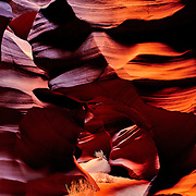 Light filters down into a unique slot canyon..With narrow rock walls, slot canyons are beautiful, but sometinmes dangerous places..This image has appeared on the cover of Arizona Highways magazine.