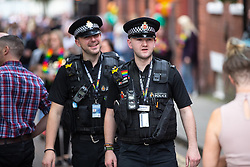 © Licensed to London News Pictures . 25/08/2017. Manchester , UK. Police on patrol in Manchester's Gay Village at the opening night of Manchester Pride's Big Weekend . The annual festival , which is the largest of its type in Europe , celebrates LGBT life . Photo credit: Joel Goodman/LNP