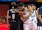 NANJING,CHINA:SEPTEMBER 5th 2019.FIBA World Cup Basketball 2019 Group phase match.Group F. New Zealand vs Greece. Shooting Guard, Corey WEBSTER is given a respectful hug at the end of the match by Small Forward Giannis ANTETOKOUNMPO<br /> .Photo by Jayne Russell / www.PhotoSport.nz