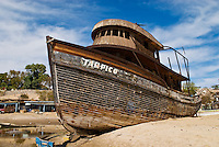 Abandoned boat sits on beach, San Felipe, Baja California, Mexico