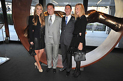 Left to right, HOLLY VALANCE, NICK CANDY, CHRISTIAN & EMILY CANDY at the launch of One Hyde Park, The Residences at Mandarin Oriental, Knightsbridge, London on 19th January 2011.