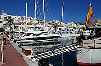 Puerto Banus, Marbella, Spain, marina, yachts, mountains, palms, palm trees, beach, blue sky, white clouds, sea shore, 201211100894..Copyright Image from Victor Patterson, 54 Dorchester Park, Belfast, UK, BT9 6RJ..Tel: +44 28 9066 1296.Mob: +44 7802 353836.Voicemail +44 20 8816 7153.Skype: victorpattersonbelfast.Email: victorpatterson@me.com.Email: victorpatterson@ireland.com (back-up)..IMPORTANT: If you wish to use this image or any other of my images please go to www.victorpatterson.com and click on the Terms & Conditions. Then contact me by email or phone with the reference number(s) of the image(s) concerned.