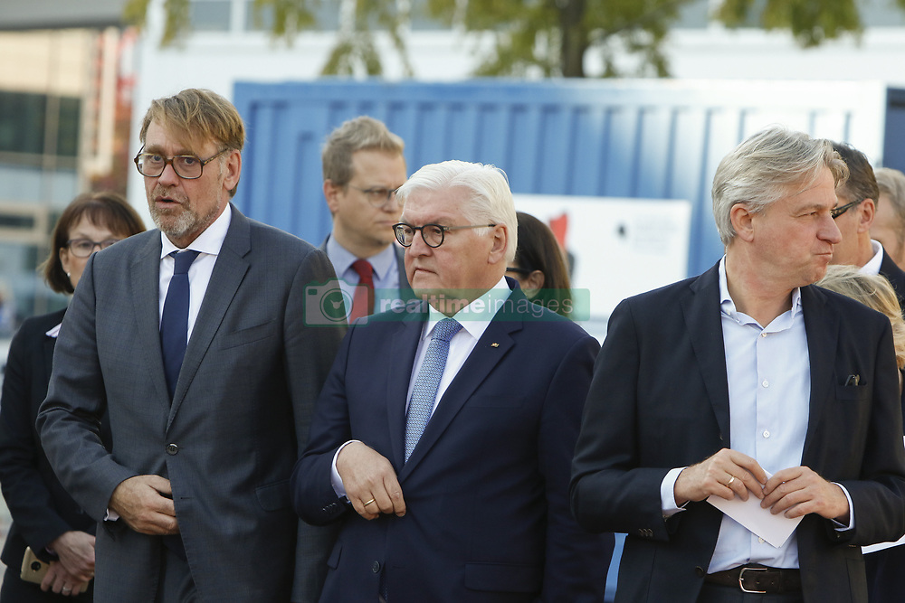 October 10, 2018 - Frankfurt, Hesse, Germany - German President Frank-Walter Steinmeier (middle) is pictured with the director of the Frankfurt Book Fair Juergen Boos (right) at the Frankfurt Book Fair. The 70th Frankfurt Book Fair 2018 is the world largest book fair with over 7,000 exhibitors and over 250,000 expected visitors. It is open from the 10th to the 14th October with the last two days being open to the general public. (Credit Image: © Michael Debets/Pacific Press via ZUMA Wire)