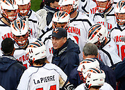 Virginia Cavaliers head coach Dom Starsia talks with his team during the game against the Johns Hopkins in Charlottesville, VA. Johns Hopkins defeated Virginia 11-10 in overtime. Photo/Andrew Shurtleff