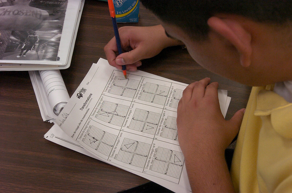 Brownsville, TX January, 2006:  Student doing a practice test on geometry transformations in study hall. ©Bob Daemmrich/