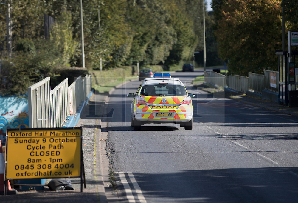 © Licensed to London News Pictures. 30/09/2016. Oxford, UK. A police car drives on the Marston Ferry Road in the Summertown area of Oxford. A police hunt continues in Oxford for two men who abducted and raped a 14-year-old girl while she was on her way to school. The teenager was snatched and driven away from the Summertown area of Oxford at 8.25 on Wednesday morning. Photo credit: Peter Macdiarmid/LNP