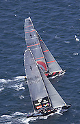 NZL81 and SUI 64 drag race in leg one of the first match of the America's Cup 2003. 15/2/2003 (© Chris Cameron 2003)