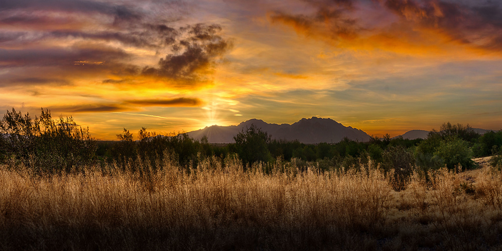 Sunrise over the Catalina Mountains looking from the Santa Cruz River area.