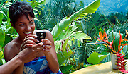 Girl with mobile phone at Strawberry Hill - Jamaica