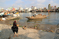 A rooster is shut up in a ca ge along Te channel (Ken Te) in District 7, Ho Chi Minh city, Vietnam, Asia