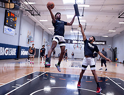 G League Ignite's Jaden Hardy shoots over coach Nick Hamilton with the team on Tuesday, Sept. 28, 2021 in Walnut Creek, Calif.