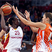 Galatasaray's Melisa CAN (L) during their Euroleague woman Group A basketball match Galatasaray between UMMC Ekaterinburg at the Abdi Ipekci in Istanbul at Turkey on wednesday,October, 26, 2010. Photo by TURKPIX