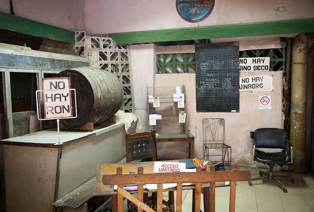 """""""There is no rum,"""" """"There is no wine,"""" """"There is no vinegar,"""" market in Havana, Cuba"""