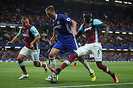 Cheikhou Kouyate of West Ham United (r)  intercepts Nemanja Matic of Chelsea.Premier league match, Chelsea v West Ham United at Stamford Bridge in London on Monday 15th August 2016.<br /> pic by John Patrick Fletcher, Andrew Orchard sports photography.