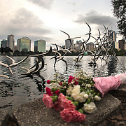 Flowers a placed at a makeshift memorial at Lake Eola Park for the victims of the Pulse nightclub where many victims were killed in the deadliest shooting in modern U.S. History on Tuesday, June 14, 2016, in Orlando, Fla. (Alex Menendez via AP)