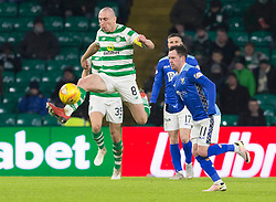 Celtic's Scott Brown (left) and St Johnstone's Danny Swanson (right) battle for the ball during the Ladbrokes Scottish Premiership match at Celtic Park, Glasgow.