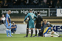 Photo: Marc Atkins.<br /> Wycombe Wanderers v Mansfield Town. Coca Cola League 2. 01/09/2006. John Mullins (R) of Mansfield receives medical attention as Tommy Mooney (L) of Wycombe looks on.
